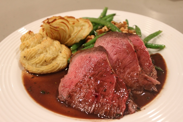 Skirt Steak with Chocolate, Rosemary and Red Win Reduction with Duchess Potatoes and Pan-Roasted Green Beans